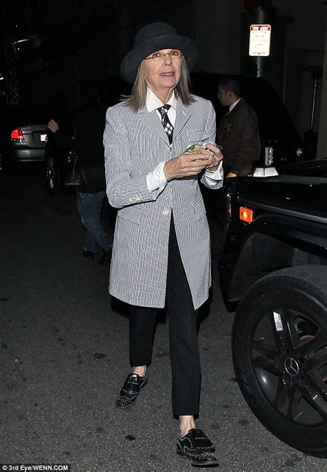 Diane Keaton heads out to dinner in signature black cap